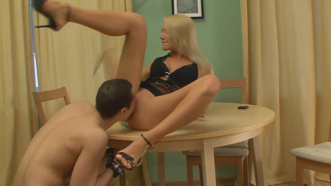 Mistress Lera Feeds her Slave at The Table