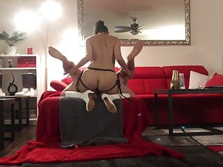 Mistress strapon fucking her slave on couch