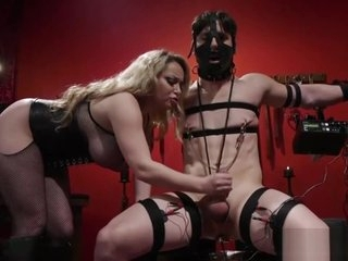 Voluptuous blonde domina and her male sex slave
