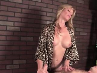 Experienced masseuse Tina plays with cock