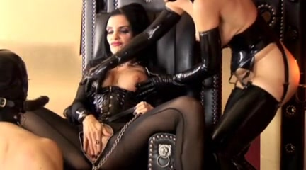 Amazing dominatrices in latex torture their slave