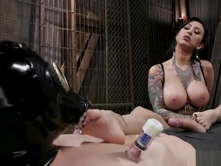 Huge tits dom in latex torments man