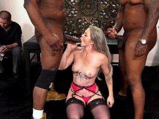 Swinger blonde sucking on 2 huge black cocks
