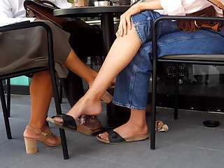 Her sexy dangling long feets soles toes in mules