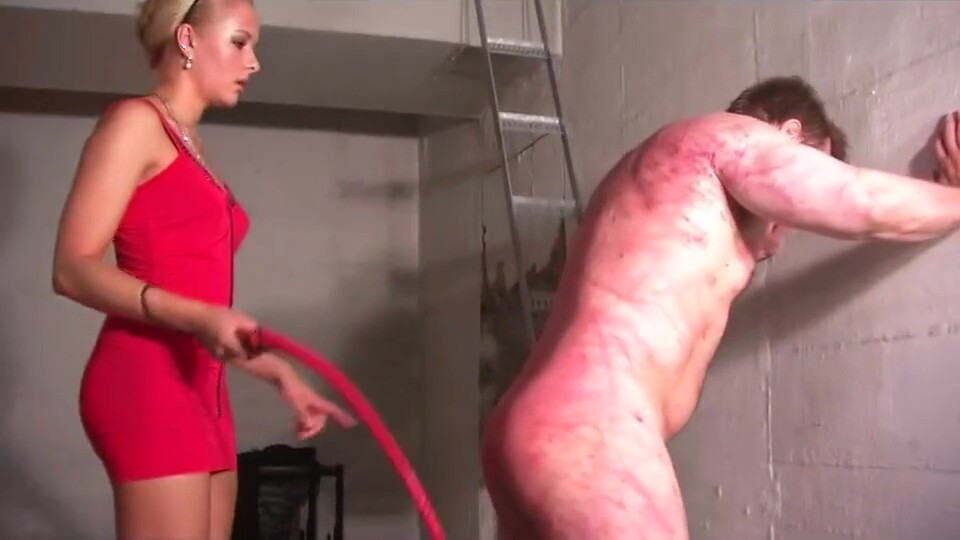 Hot young blonde angry mistress in red dress punishes her slave