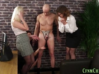 Classy dominas toying sissys ass